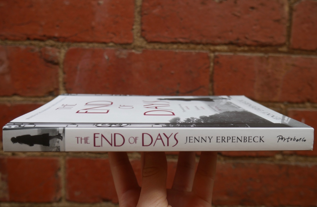 The End of Days book by Jenny Erpenbeck against a brick wall