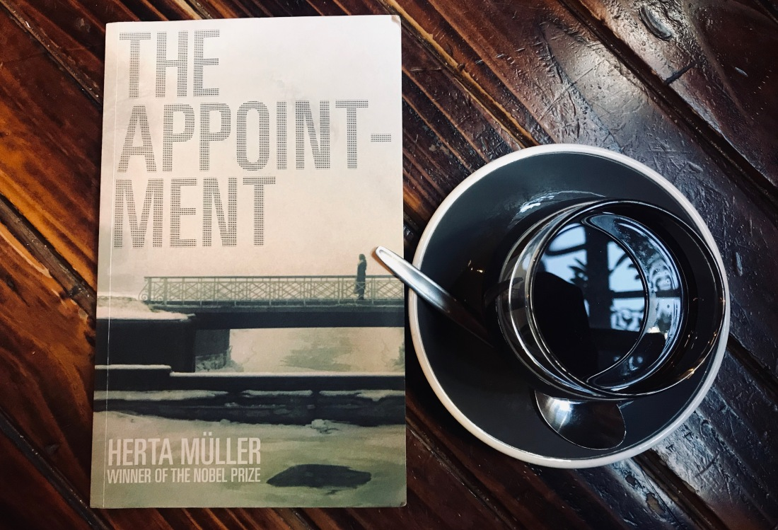 book 'the appointment' and black coffee on table
