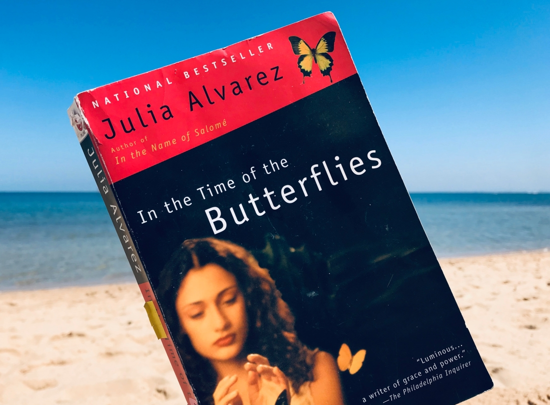 In the Time of Butterflies against blue sky and sea