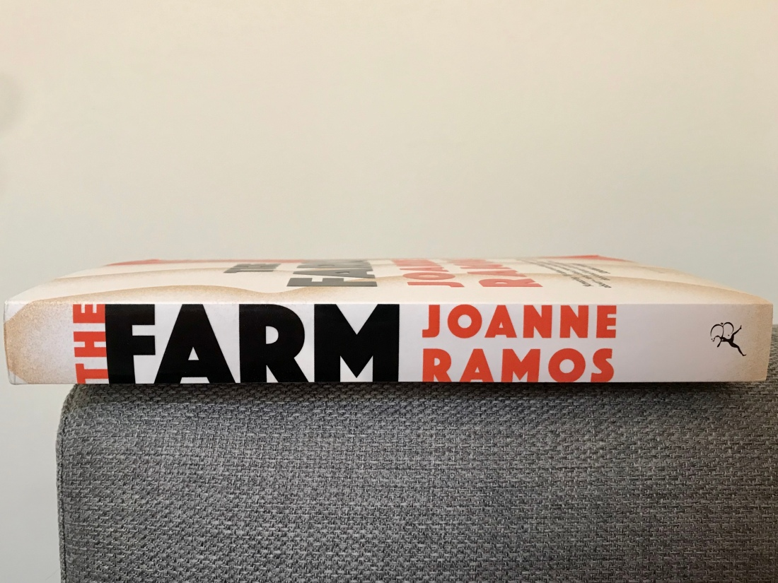 book spine on side of sofa, the farm by joanne ramos