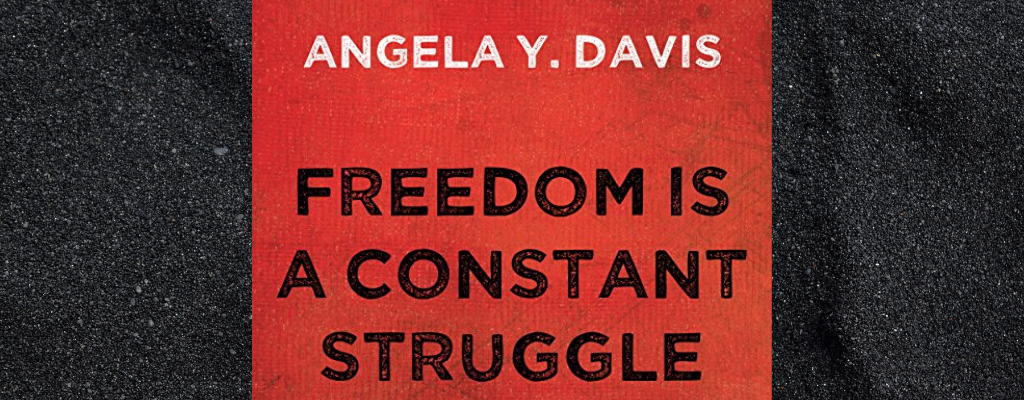 Red book cover with text reading: Angela Y Davis, Freedom Is A Constant Struggle