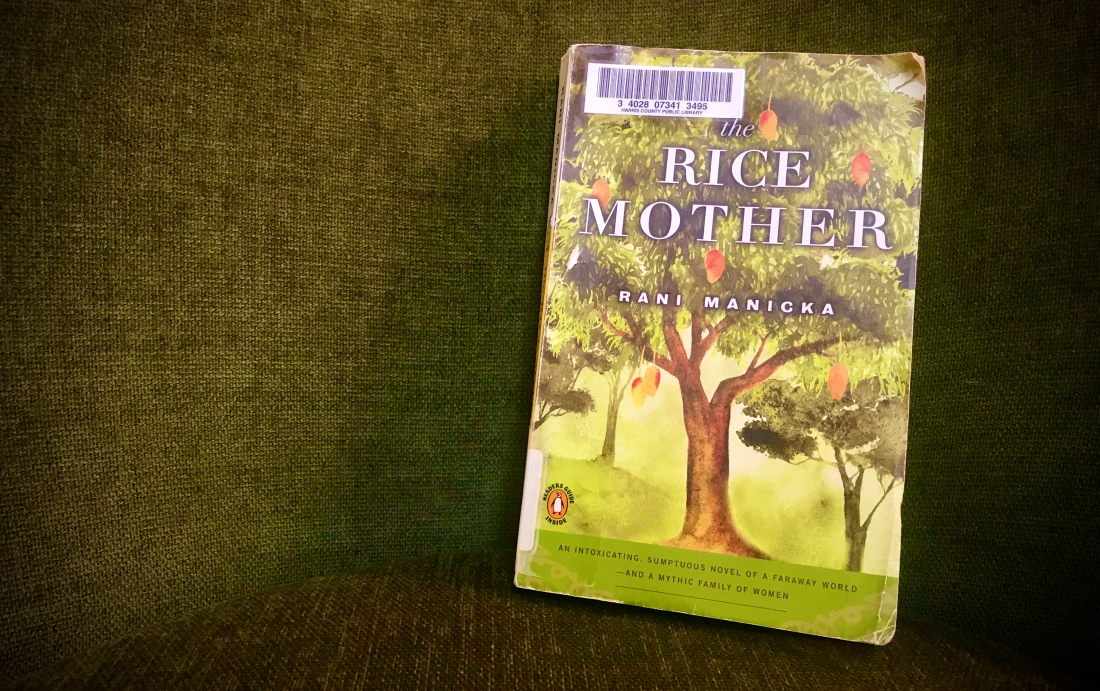 Rice Mother book with tree and orange fruit hanging on cover, plain green background
